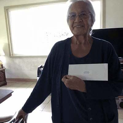 Woman Winning Window Hawaii Referral Prize